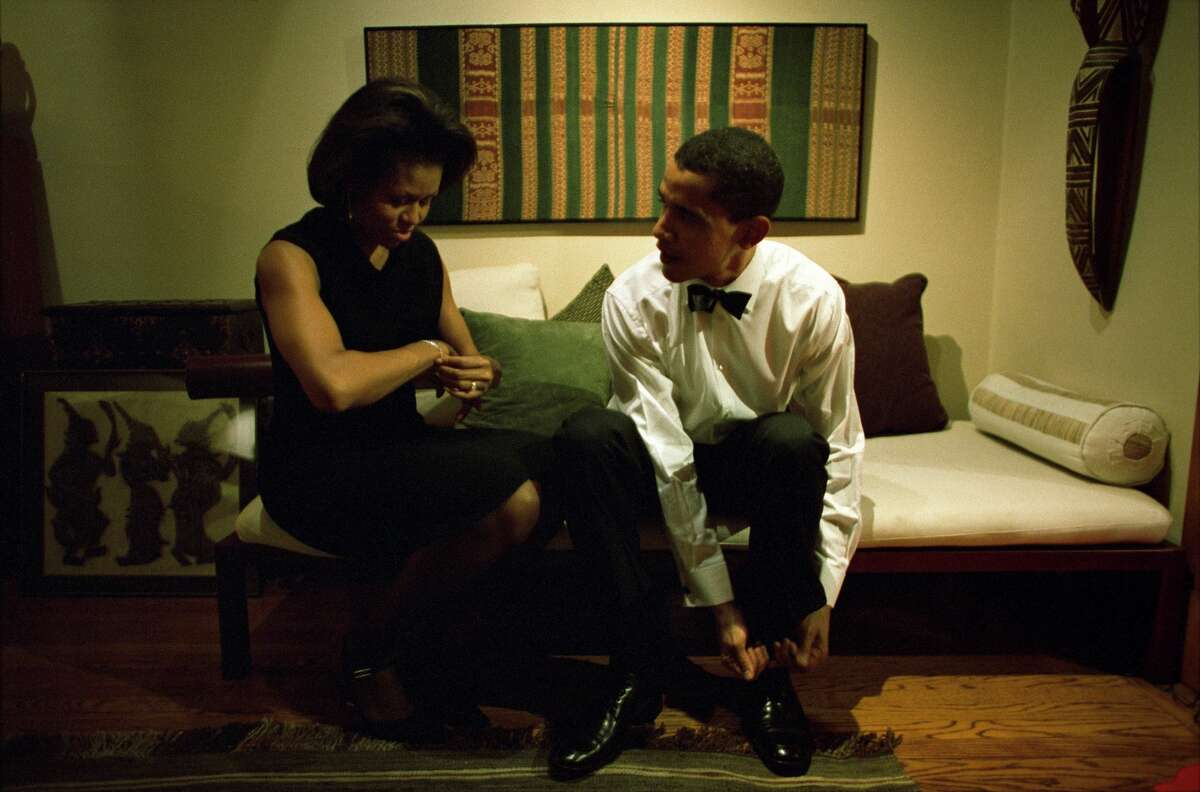 Barack Obama and his wife, Michelle get ready at their home on December 8, 2004, in Chicago, Illinois.