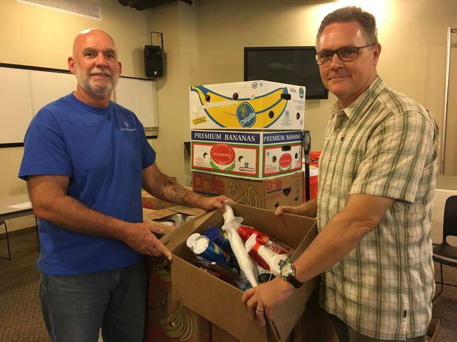 Hurricane Harvey relief efforts continue at The Fellowship at Cinco Ranch including distribution of boxes of supplies. Among church leaders working on Project Restoration are, from left, Glenn Lerich, missions pastor, and Jerry Edmonson, founding and lead pastor. Photo: Karen Zurawski