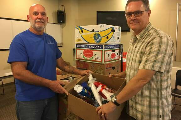 Hurricane Harvey relief efforts continue at The Fellowship at Cinco Ranch including distribution of boxes of supplies. Among church leaders working on Project Restoration are, from left, Glenn Lerich, missions pastor, and Jerry Edmonson, founding and lead pastor.