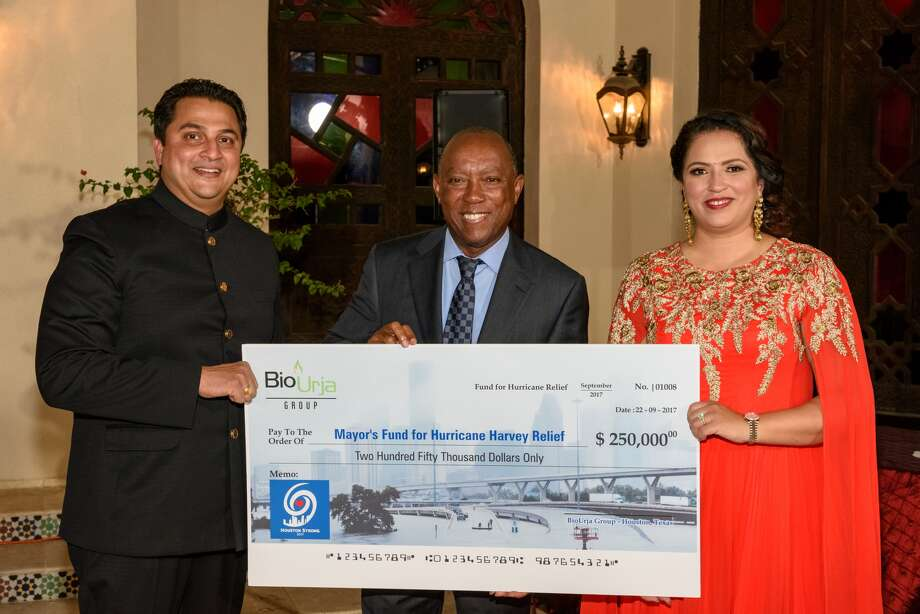 Indo-American community representatives Amit and Arpita Bhandari present a check of $250,000 to Houston Mayor Sylvester Turner (center) toward the Mayor's Fund for Hurricane Harvey Relief. In total, the Indo-American community has made a contribution of $1.5 million toward Hurricane Harvey relief. Photo: Submitted Photo