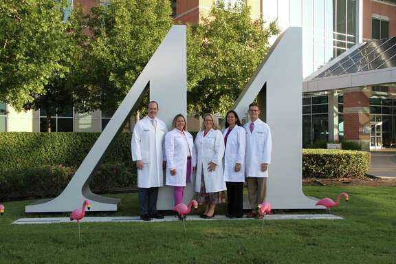 Breast care specialists at Houston Methodist West Hospital observe Breast Cancer Awareness Month, including Dr. Warren A. Ellsworth IV, plastic and reconstructive surgeon; Dr. Candy Arentz, breast surgeon; Dr. Kathleen Shadle, radiation oncologist; Dr. Rajul Mehta, breast radiologist; and Dr. Rodger H. Brown, plastic and reconstructive surgeon.