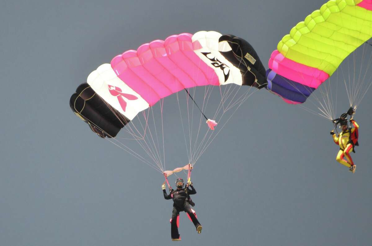 Marian Sparks, breast cancer survivor and founder of Jump for The Rose, prepares to hit the landing zone at Skydive Spaceland in Rosharon, Texas.