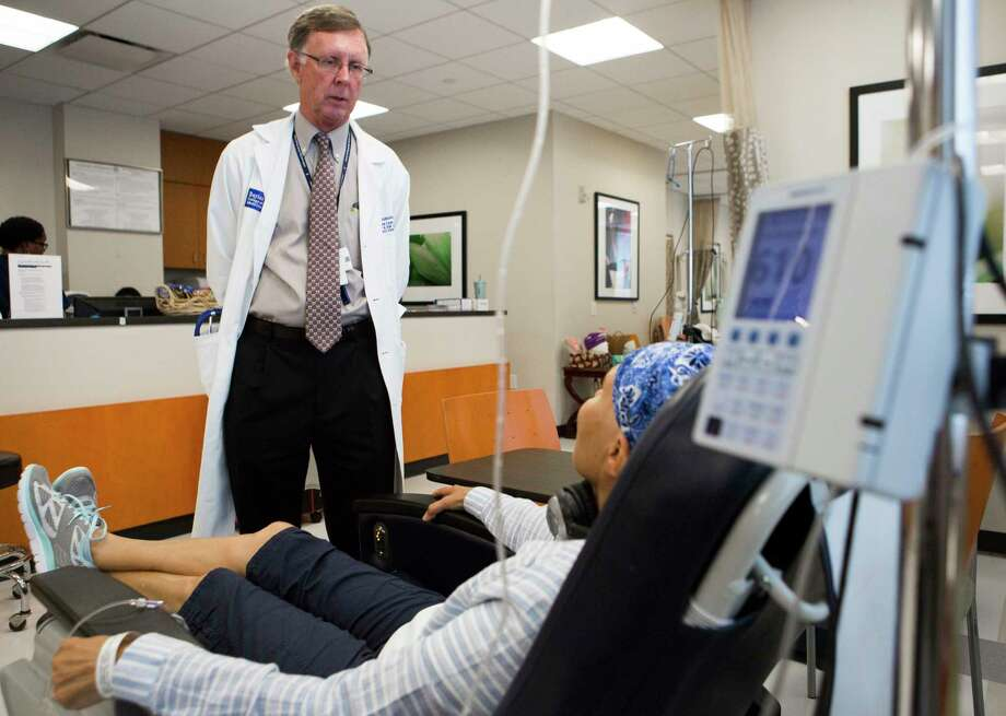 Dr. Kent Osborne, director of Baylor's cancer center, visits his patient Cheryl Engle who is undergoing chemotherapy treatment. Baylor College of Medicine's Dan L. Duncan Cancer Center has been awarded National Cancer Institute Comprehensive Status, the highest and most prestigious designation possible by the NCI. Thursday, July 30, 2015, in Houston  ( Marie D. De Jesus / Houston Chronicle ) Photo: Marie D. De Jesus, Staff / © 2015 Houston Chronicle