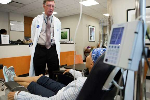Dr. Kent Osborne, director of Baylor's cancer center, visits his patient Cheryl Engle who is undergoing chemotherapy treatment. Baylor College of Medicine's Dan L. Duncan Cancer Center has been awarded National Cancer Institute Comprehensive Status, the highest and most prestigious designation possible by the NCI. Thursday, July 30, 2015, in Houston  ( Marie D. De Jesus / Houston Chronicle )
