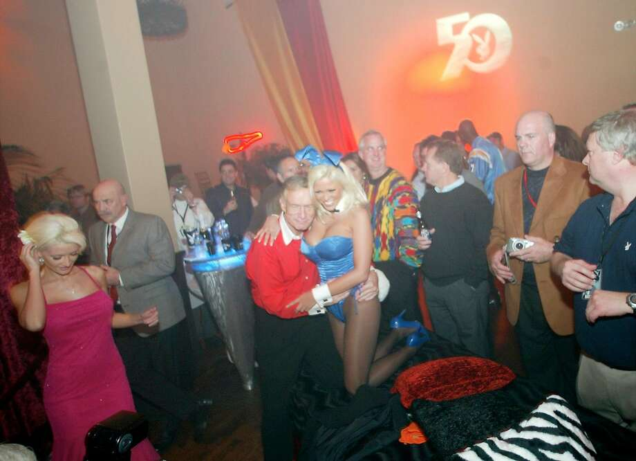 Hugh Hefner and a bunny at his San Diego Super Bowl party in 2003 Photo: BRANT WARD, SFC