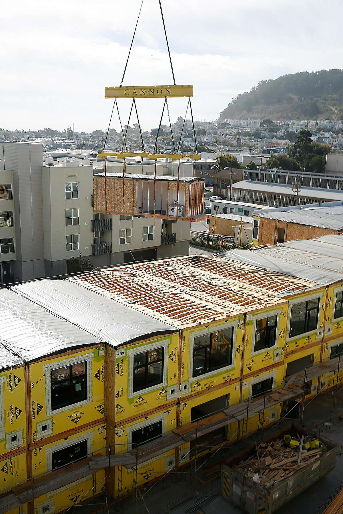 A 136-unit rental modular housing project takes place in the Bayview in San Francisco, Calif., on Monday, September 28, 2015. Construction for placing the modular units is on it's sixth day where the second floor of units is already three quarters placed.
