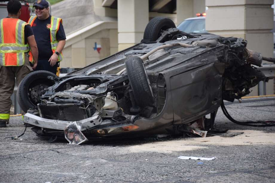 A woman was hospitalized in critical condition Tuesday after she drifted off U.S. Highway 90, flipped over into oncoming traffic and became trapped in her vehicle. Photo: Caleb Downs / San Antonio Express-News
