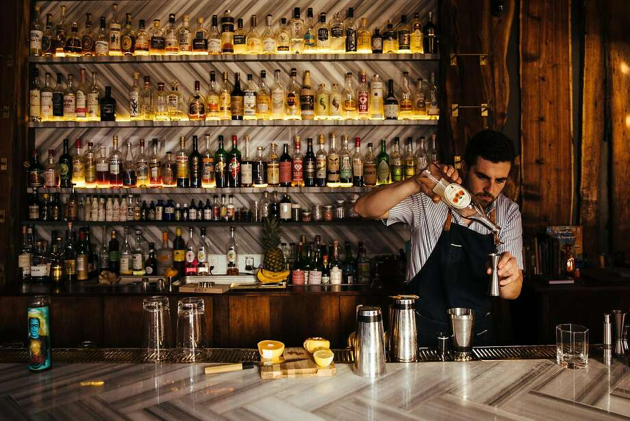 Alex Alotte pours the apricot liqueur into the glass at Biig in San Francisco, Calif. Monday, October 2, 2017. Photo: Mason Trinca, Special To The Chronicle