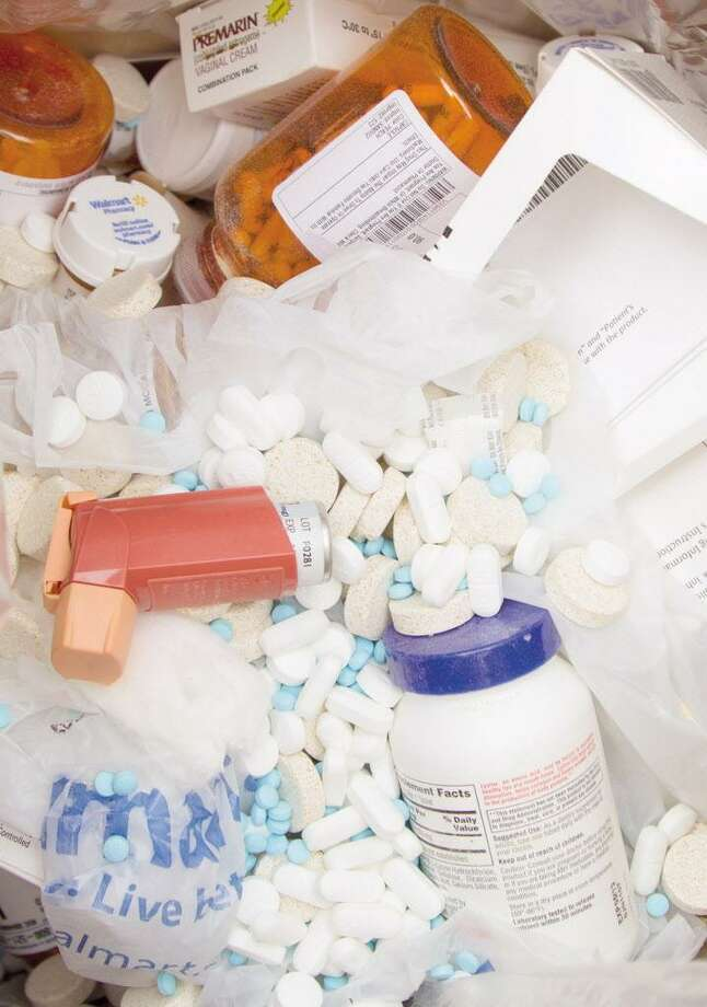 Local police work with the federal Drug Enforcement Administration to collect prescription medication during National Prescription Drug Take Back Day. Photo: Hearst Connecticut Media File Photo / Conroe Courier