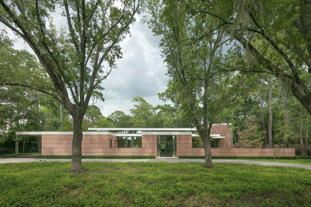 420 Oak: The home's primary materials are brick, concrete, steel and glass.
