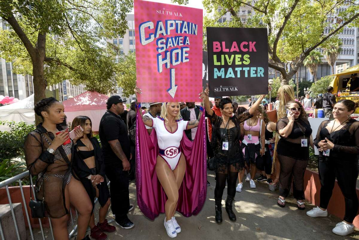 Model Amber Rose and her mother Dorothy Rose hold signs during the third annual Amber Rose SlutWalk in Los Angeles, California.