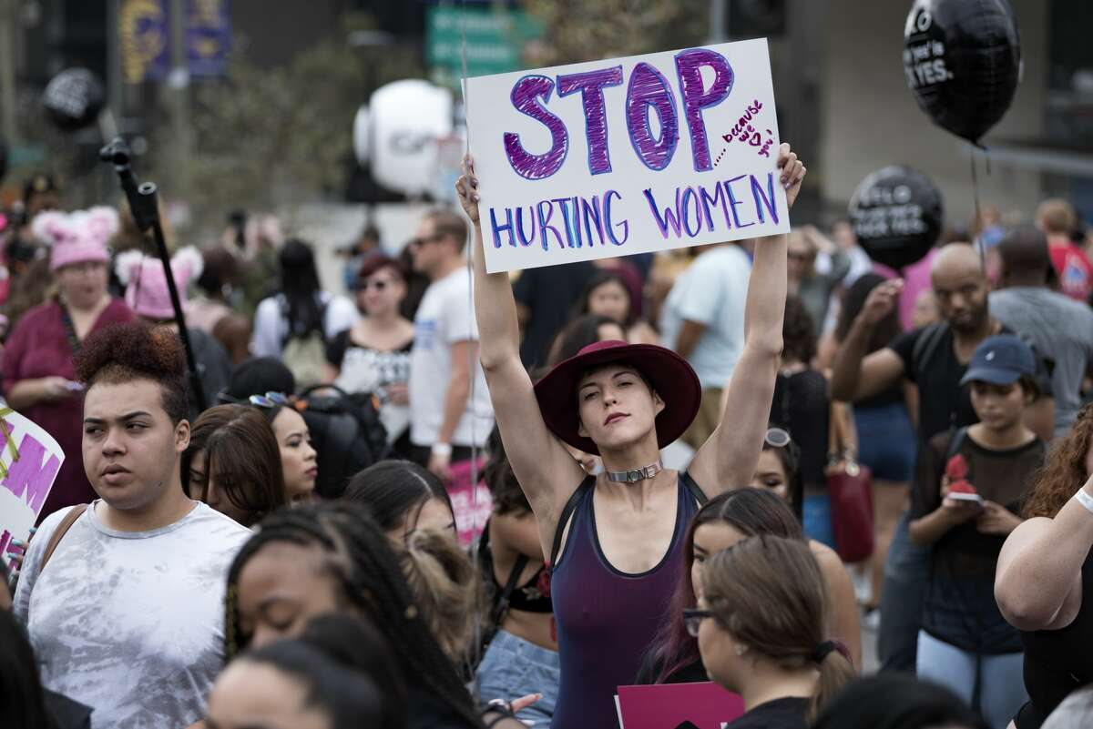 """Women's rights activists march against gender inequality in what the organizers called 'the third annual Amber Rose """"SlutWalk"""" in downtown Los Angeles."""