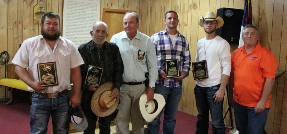 Five volunteers received plaques for their hard work and service in helping the San Jacinto County community during the storms of Hurricane Harvey. Pictured left to right are Adam Crawford, Daniel Pete Sampson, San Jacinto County Pct. 3 Constable Sam Houston, Justin Syphrett, Micah Hudman and Stan Jolly of the Montgomery County Sheriff's Department. Not pictured: Norman L. Houston. Photo: Jacob McAdams
