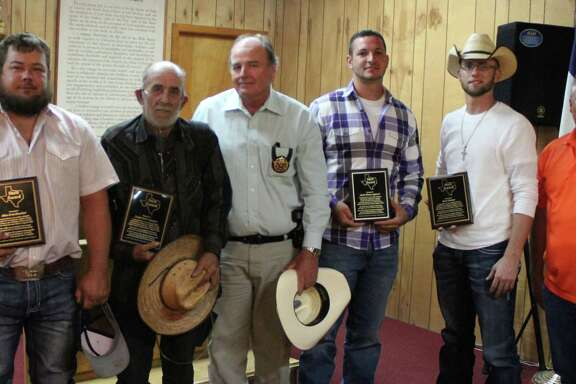 Five volunteers received plaques for their hard work and service in helping the San Jacinto County community during the storms of Hurricane Harvey. Pictured left to right are Adam Crawford, Daniel Pete Sampson, San Jacinto County Pct. 3 Constable Sam Houston, Justin Syphrett, Micah Hudman and Stan Jolly of the Montgomery County Sheriff's Department. Not pictured: Norman L. Houston.