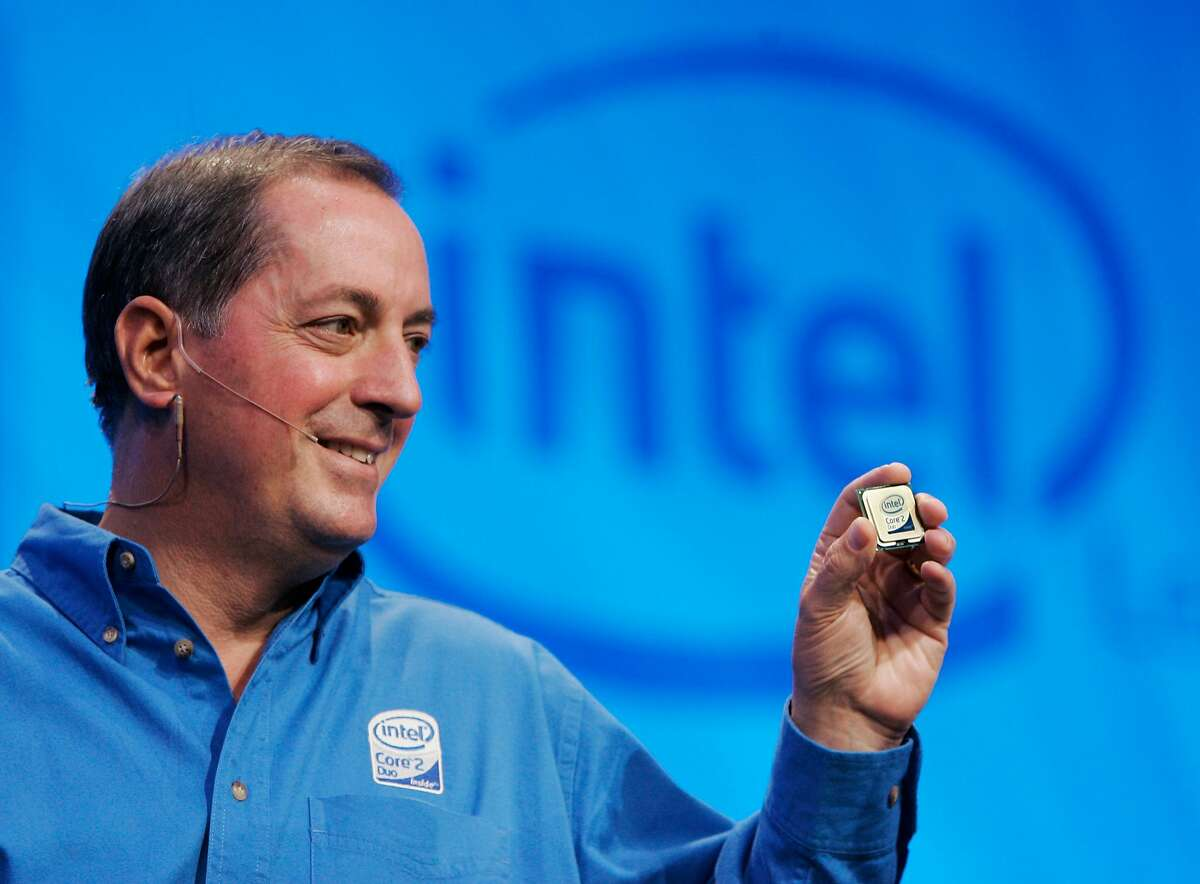 Intel Corp. CEO Paul Otellini holds up their newest chip at an unveiling at Intel headquarters in Santa Clara, Calif., Thursday, July 27, 2006. Otellini received compensation the company valued at $6.18 million in 2006, a year in which the company undertook a massive restructuring to reverse sinking profits but also fired back against its archrival with a strong new product lineup. Otellini got a 15 percent boost in his salary this year to $700,000, according to a filing Tuesday with the Securities and Exchange Commission. (AP Photo/Paul Sakuma)