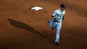BALTIMORE, MD - AUGUST 30: Mitch Haniger #17 of the Seattle Mariners rounds the bases after hitting a solo home run against the Baltimore Orioles in the eighth inning at Oriole Park at Camden Yards on August 30, 2017 in Baltimore, Maryland.  (Photo by Rob Carr/Getty Images)