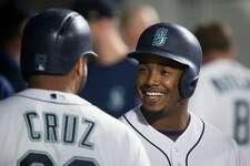 SEATTLE, WA - SEPTEMBER 02: Jean Segura #2 of the Seattle Mariners smiles as he's congratulated by Nelson Cruz #23 after hitting a solo home run in the fifth inning against the Oakland Athletics at Safeco Field on September 2, 2017 in Seattle, Washington. (Photo by Lindsey Wasson/Getty Images)