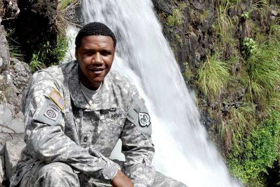 In this June 6, 2015 photo, U.S. Army National Guard Sgt. 1st Class Charleston Hartfield of the 100th Quartermaster Company poses for a photo at Rainbow Falls near Hilo, Hawaii. Hartfield was one of the people killed in Las Vegas after a gunman opened fire on Sunday, Oct. 1, 2017, at a country music festival. (Sgt. Walter Lowell/U.S. Army National Guard via AP)