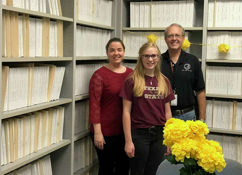 Former Alvin High School student Suzanne Finger, center, reorganized the school's music library before she graduated this year. The project grew to involve donations from local church and civic groups and businesses, says head choir director Kelsy Holt, shown with another school choir leader, John Cunningham.