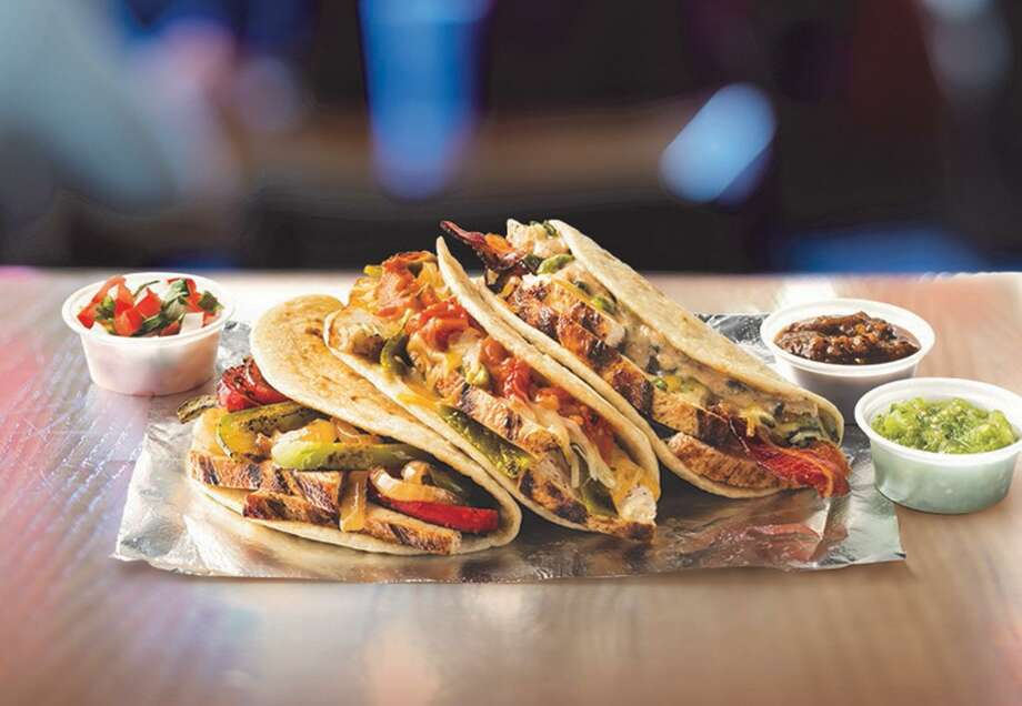 Taco Cabana is releasing a line of three different varieties of flame-grilled chicken tacos to the menu starting on Monday. Flavors include grilled peppers and onions with salsa roja, roasted polanos with ranchero sauce and cheese, and bacon and jalapeño with salsa ranch. Pricing will be $2.29 each or mix and match any three for $5.99. Photo: Courtesy Taco Cabana