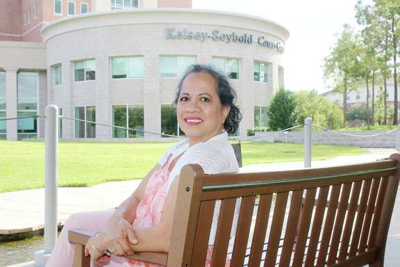 Mercy Siaotong, cancer survivor, poses for a photo at the Kelsey Sebold Main Campus. Photo by Pin Lim.