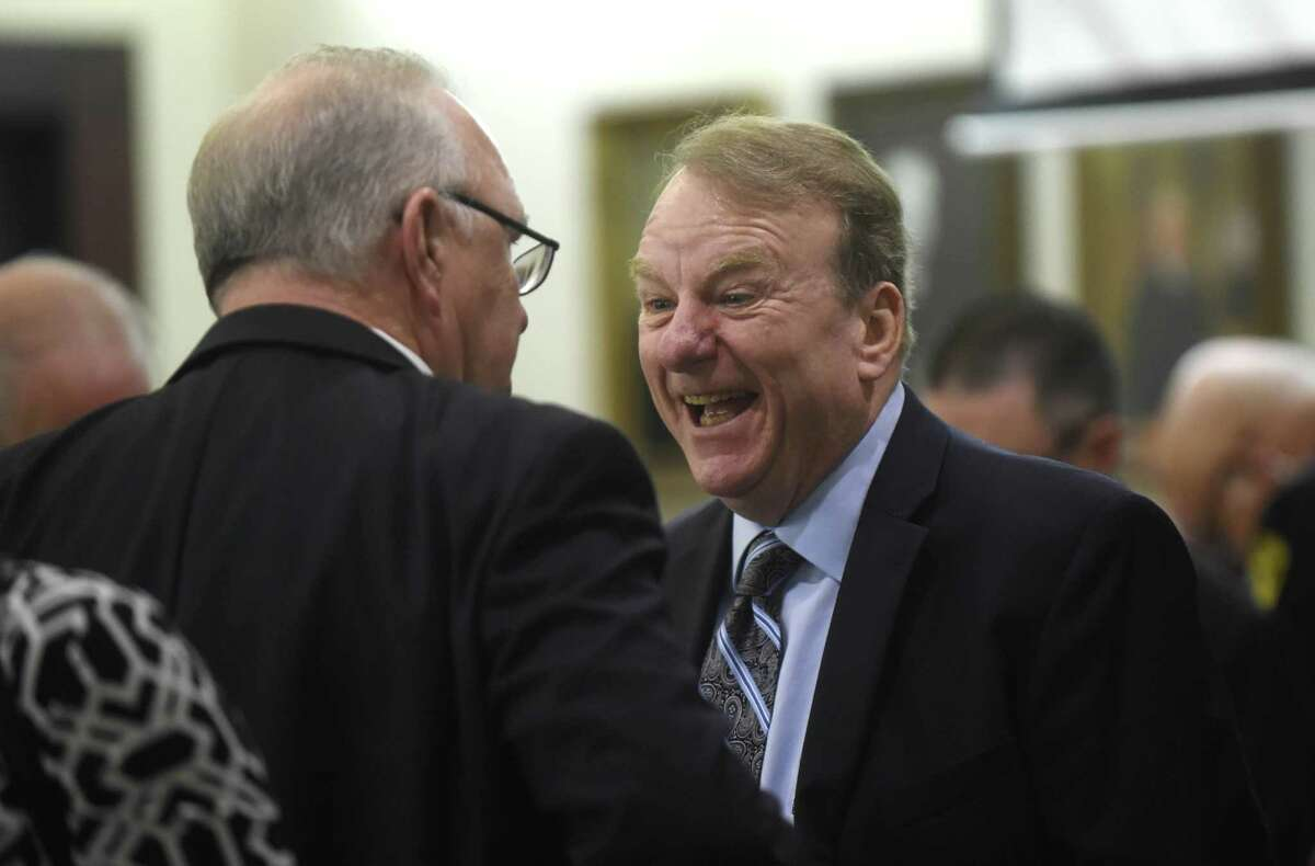 John Morgan Campbell (right), 66, speaks with attorney Charlie Baird in 175th District Court in October.