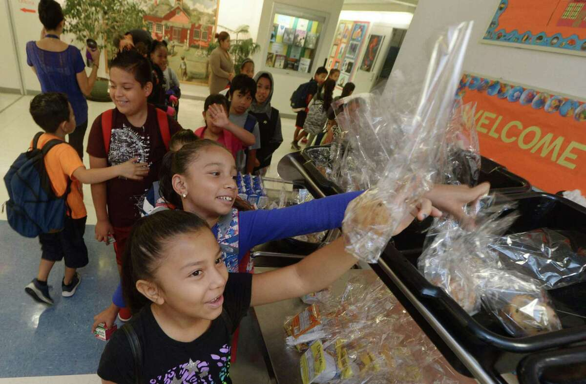Third-graders Ayleen Escobar and Kaylie Regalado take part in Brookside Elementary School's breakfast program Tuesday, Sept. 26, at the school in Norwalk. Norwalk Public Schools has been awarded a $52,000 grant from the American Association of School Administrators to expand its