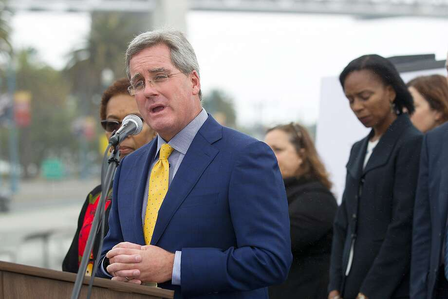 SF city attorney Dennis Herrera (at podium) and  Oakland city attorney Barbara Parker (behind him) announce they had filed separate lawsuits on behalf of their respective cities against the five-largest investor-owned producers of fossil fuels on the Embardadero at Brannan streets on Wednesday, September 20, 2017, in San Francisco, Calif. Photo: Liz Hafalia / The Chronicle