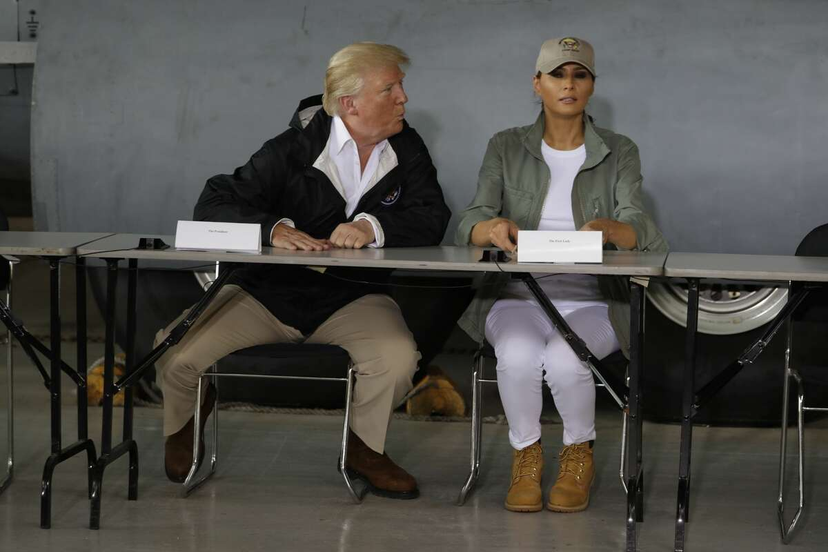 President Donald Trump and first lady Melania Trump attends a meeting after arrival at the Luis Muñiz Air National Guard Base in San Juan, Puerto Rico, Tuesday, Oct. 3, 2017. Trump is visiting Puerto Rico in the wake of Hurricane Maria.(AP Photo/Evan Vucci)