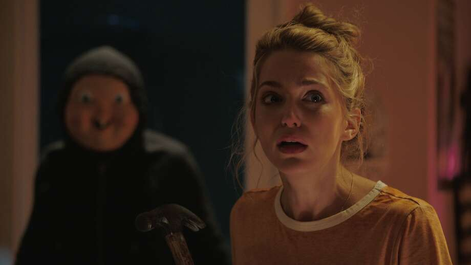 "Jessica Rothe stars in ""Happy Death Day,"" in which her character is murdered by a masked attacker. Photo: Blumhouse"