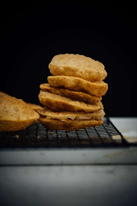 Puri fresh out of the fryer. Photo: Nik Sharma
