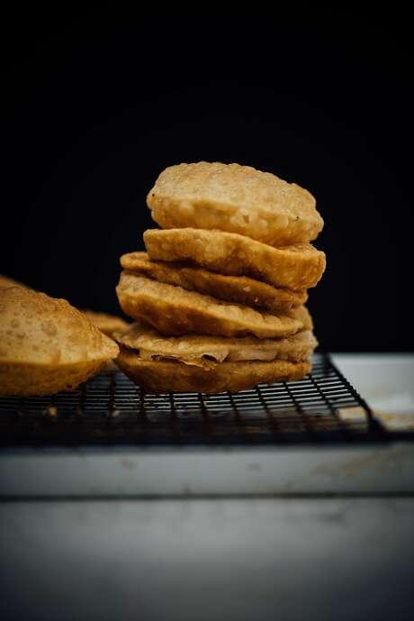 Puri fresh out of the fryer. Photo: Nik Sharma