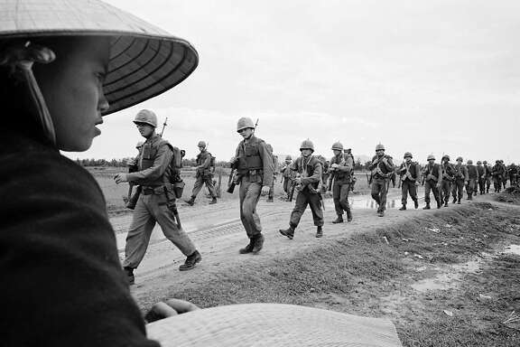 """Marines marching in Danang. March 15, 1965. Image used in """"The Vietnam War,"""" a film by Ken Burns and Lynn Novick for PBS"""