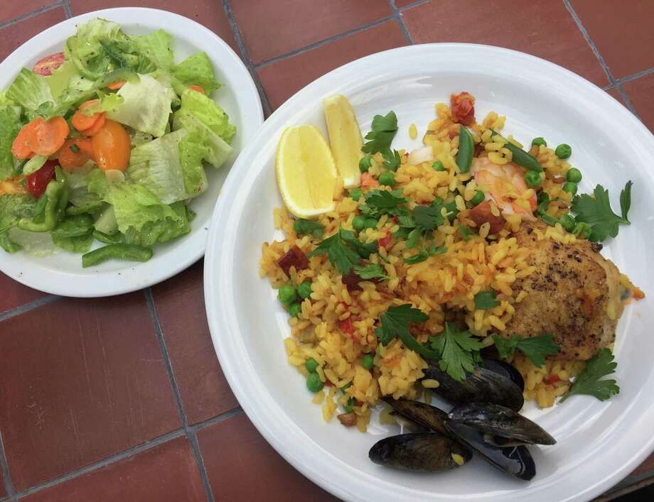 Paella and salad were a recent featured meal at Outlaw Kitchens. Photo: Paul Stephen / San Antonio Express-News