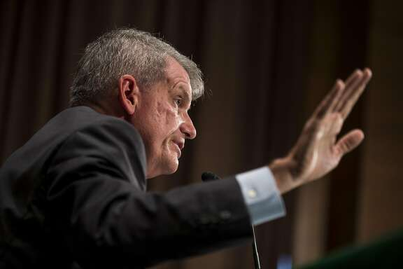 "Tim Sloan, chief executive officer and president of Wells Fargo & Co., speaks during a Senate Banking, Housing and Urban Affairs Committee hearing in Washington, D.C., U.S., on Tuesday, Oct. 3, 2017. After a ""humbling and challenging"" year, Sloan�is set to outline the steps the bank has taken in response to its bogus-accounts scandal that brought down his predecessor,�John Stumpf. Photographer: Zach Gibson/Bloomberg"