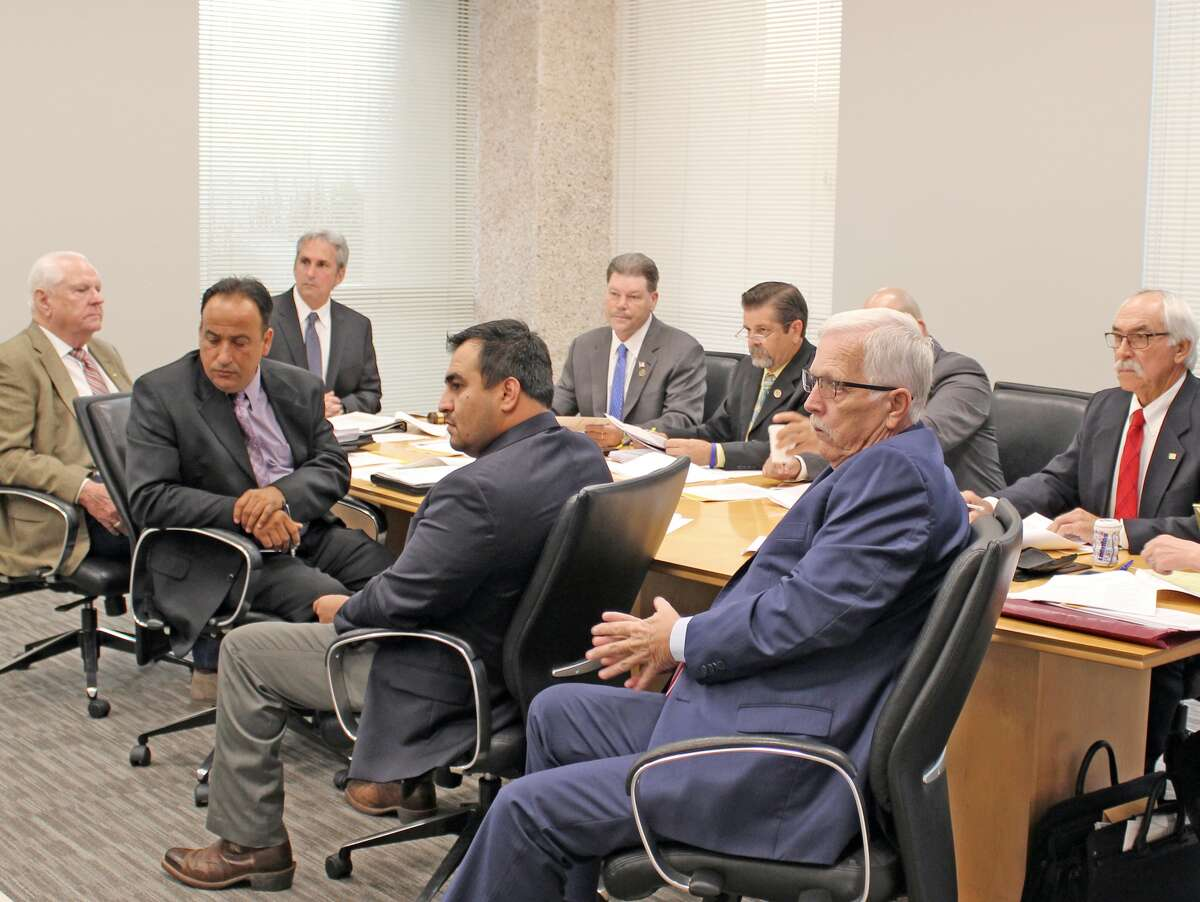 The Pasadena City Council voted Tuesday to approve a $1.1 million settlement agreement that ended an appeal of a federal judge's December ruling that a council voting plan discriminated against the city's Latino voters. Shown from left to to right are Pasadena Council members Don Harrison and Felipe Villarreal, Mayor Jeff Wagner, and Council members Cody Ray Wheeler, Thomas Schoenbein, Cary Bass, Bruce Leamon and Phil Cayten