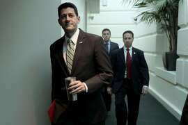 WASHINGTON, DC - OCTOBER 03:  Speaker of the House Paul Ryan (R-WI) arrives ahead of the weekly House GOP conference meeting at the U.S. Capitol October 3, 2017 in Washington, DC. Ryan and fellow Republican leaders were joined in the meeting by Majority Whip Steve Scalise (R-LA), his first conference meeting since being shot during a Congressional sports practice in June.  (Photo by Chip Somodevilla/Getty Images)