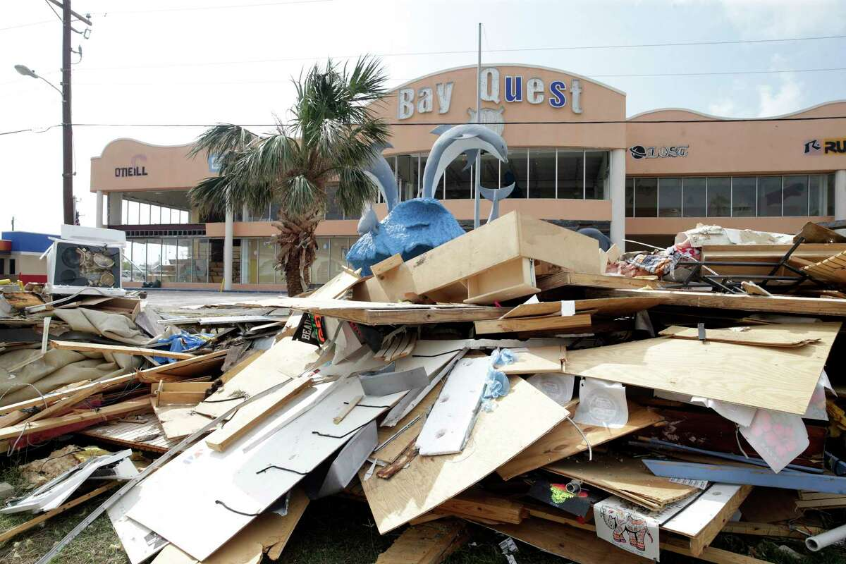 Roads in town are lined with debris piles as building contents are gutted during the recovery from Hurricane Harvey in Port Aransas on September 27, 2017.