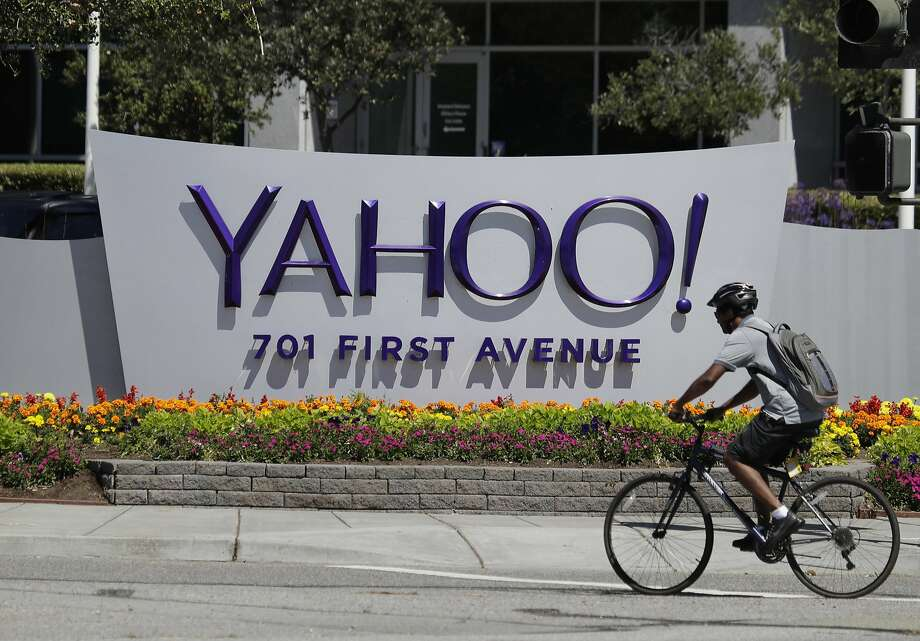 A cyclist rides past a Yahoo sign at the company's headquarters in Sunnyvale. Yahoo said Tuesday that the number of people impacted by a massive security breach in 2013 was three times larger than it had announced earlier — and all accounts were affected. Photo: Marcio Jose Sanchez, Associated Press