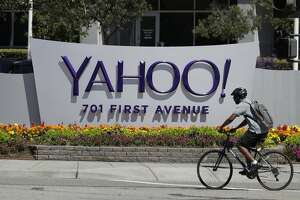 FILE - In this Tuesday, July 19, 2016 file photo, a cyclist rides past a Yahoo sign at the company's headquarters in Sunnyvale, Calif. The Yahoo hack announced Wednesday, Dec. 14, 2016 exposed personal details from more than 1 billion user accounts, potentially the largest breach of an email provider in history. (AP Photo/Marcio Jose Sanchez)