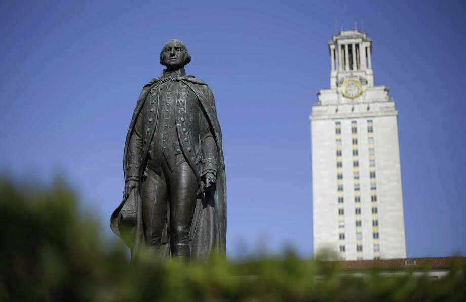 A statue of George Washington stands near the University of Texas Tower at the center of campus in 2012. A 2017 study found that the median family income at UT Austin is more than $120,000, when the state median income was around $56,000. Photo: Eric Gay /Associated Press / Internal