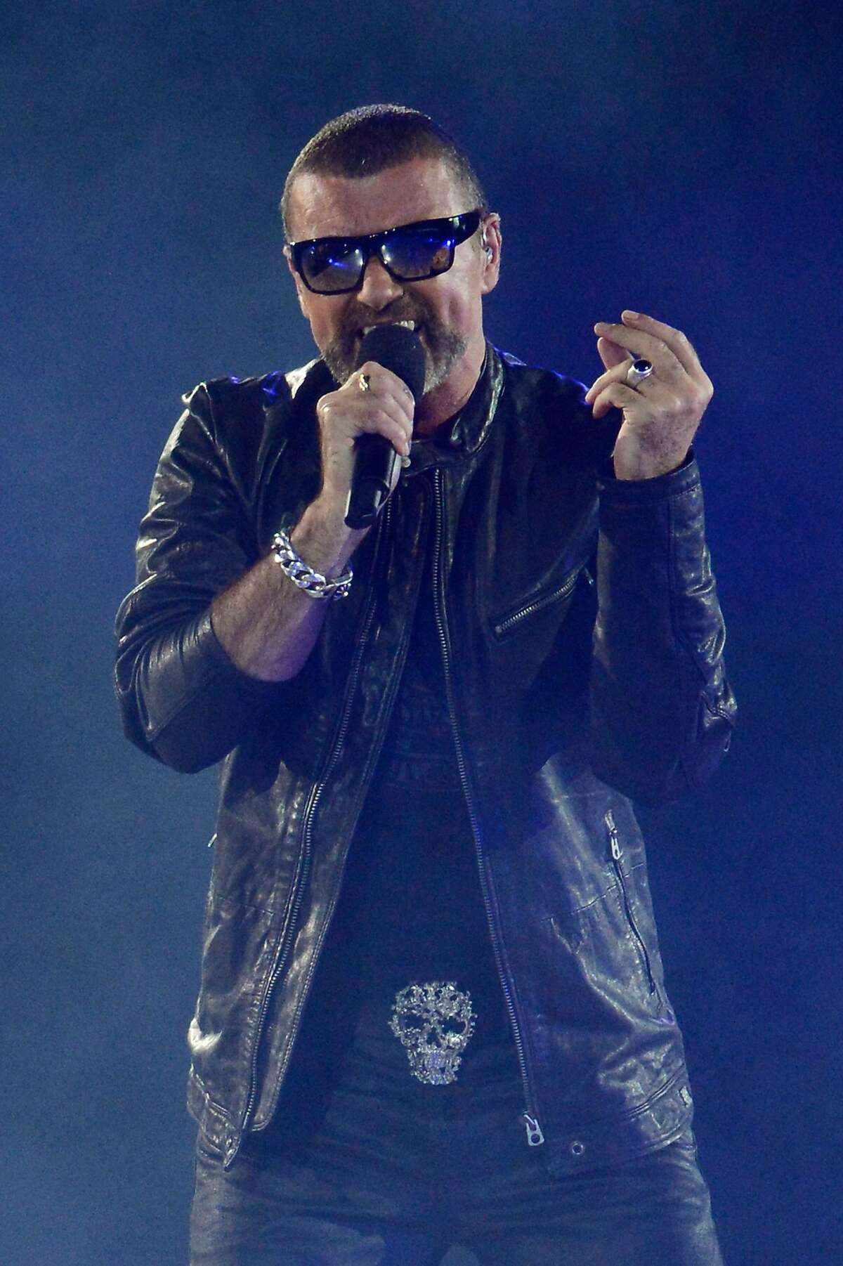 (FILES) This file photo taken on August 12, 2012 shows British singer George Michael performing during the closing ceremony of the 2012 London Olympic Games at the Olympic stadium in London on August 12, 2012. A previously unheard song by British pop icon George Michael is set for its first radio play on September 7, 2017, the first such release since the musician's death last year, his former publicist said. The new single from Sony Music will be played on BBC Radio 2 at 0800 GMT, publicist Connie Filippello said on Wednesday, without naming the song or giving further details. / AFP PHOTO / ADRIAN DENNISADRIAN DENNIS/AFP/Getty Images