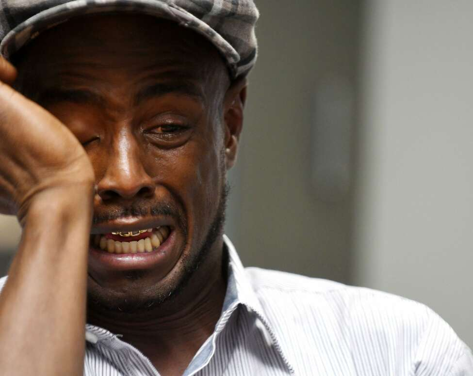 Carl Dukes cries as he recalls the time he spent in prison for a murder he didn't commit during an interview at the Times Union. (Will Waldron/Times union)