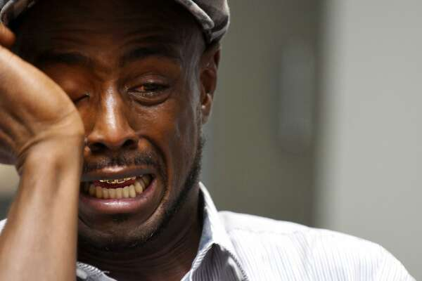 Carl Dukes cries as he recalls the time he spent in prison for a murder he didn't commit on Monday, Sept. 26, 2017, during an interview at the Times Union in Colonie, N.Y. Dukes served 20 years before he was released earlier this year after another man confessed to the crime. (Will Waldron/Times union)