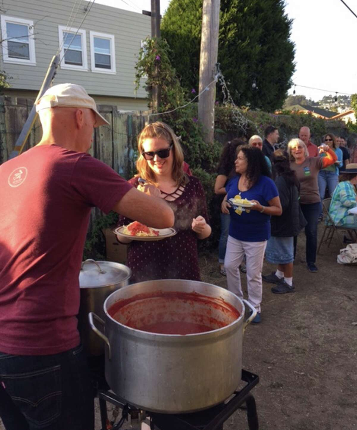John Hogeland dishes up his meatless marinara sauce at the annual Mission Terrace Alley Party.