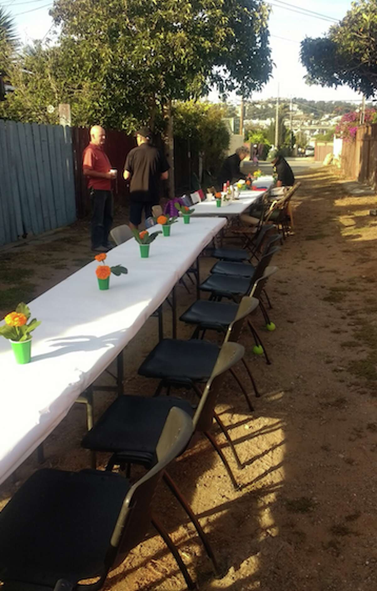 The tables are arranged and decorated in the afternoon before the annual Mission Terrace Alley Party.