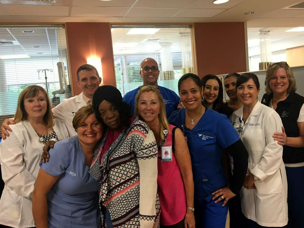 Dahlia Clarke Hanshaw (fourth from left in print sweater) with her Norma Pfriem Breast Center and Smilow Cancer Care Center providers at Park Avenue Medical Center. Hanshaw will be featured on NBC?'s TODAY Show between 8 - 8:30 am Thursday, Oct. 5. Photo courtesy of Bridgeport Hospital.