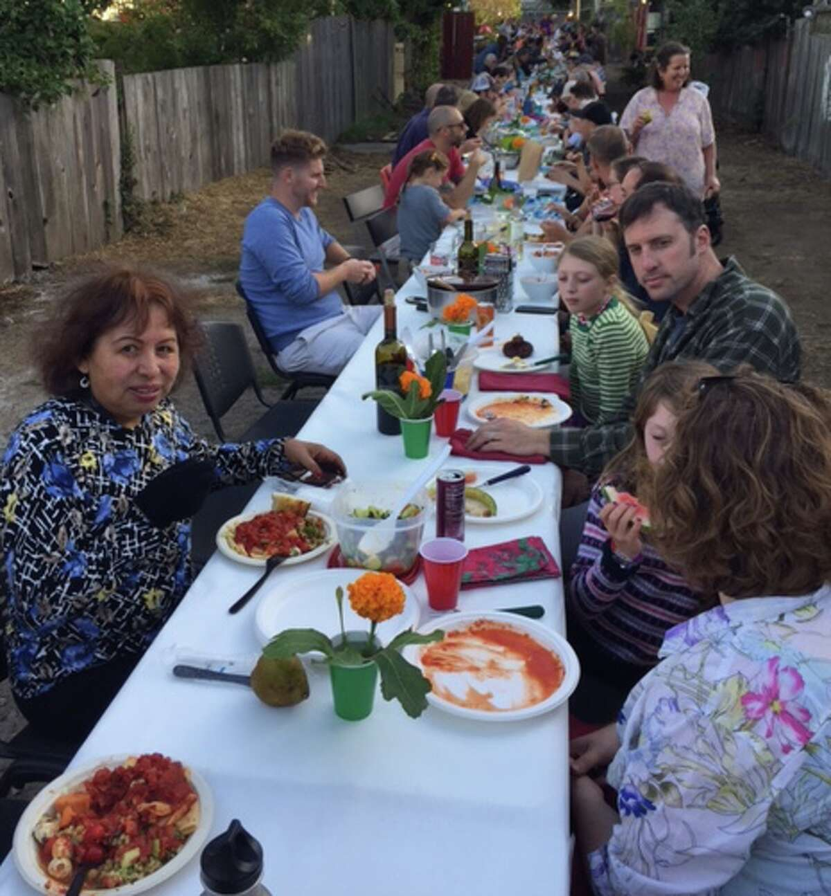 Everyone sits down for their pasta dinner at the annual Mission Terrace Alley Party.