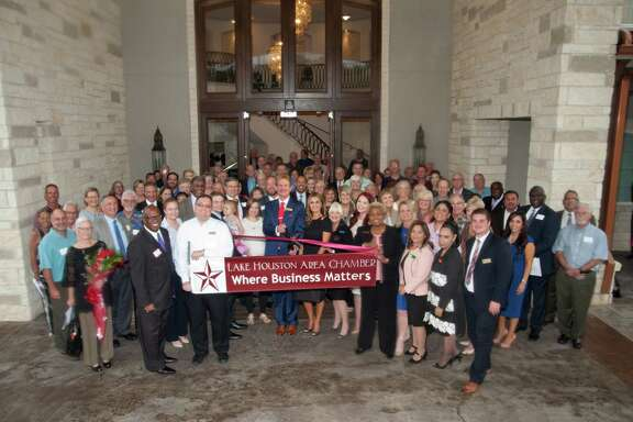 """Members of the Lake Houston Area Chamber """"cut the ribbon"""" officially opening Rosewood Funeral Home Atascocita. Photo by Chuck Thompson"""