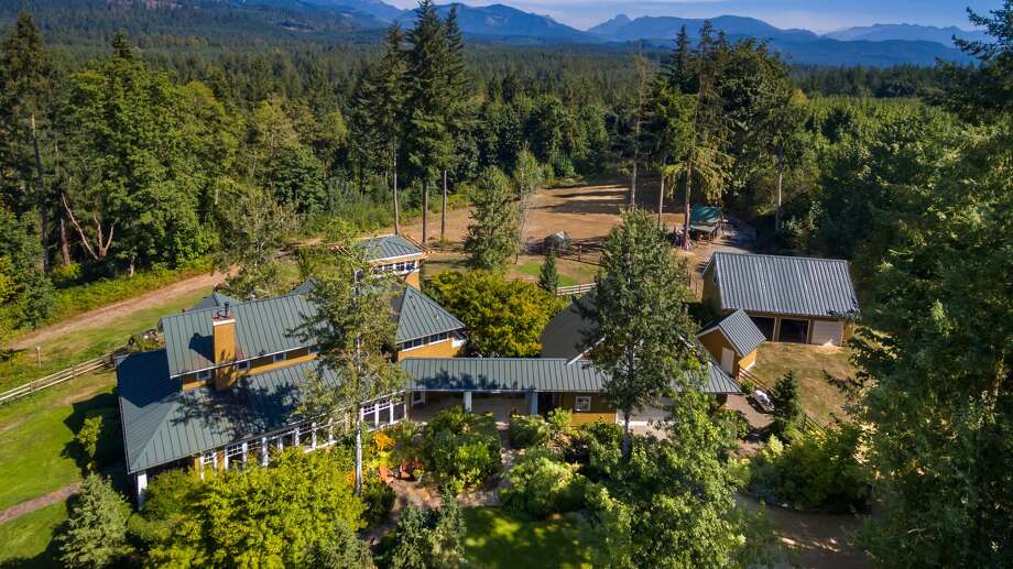 Joy Ranch is a 20-acre property located in Carnation, Washington. The four-bedroom home spans 5,700 square feet and was built in 1997.It has a five-car garage and additional guest houses on the property. Photo: Listing Courtesy Of Chris Doucet, Sotheby's International Realty